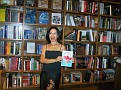 Enthusiastic and positive Mimi Gabriel facing her guests and presenting the book.
