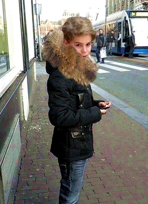 Cute fur boy standing on the street