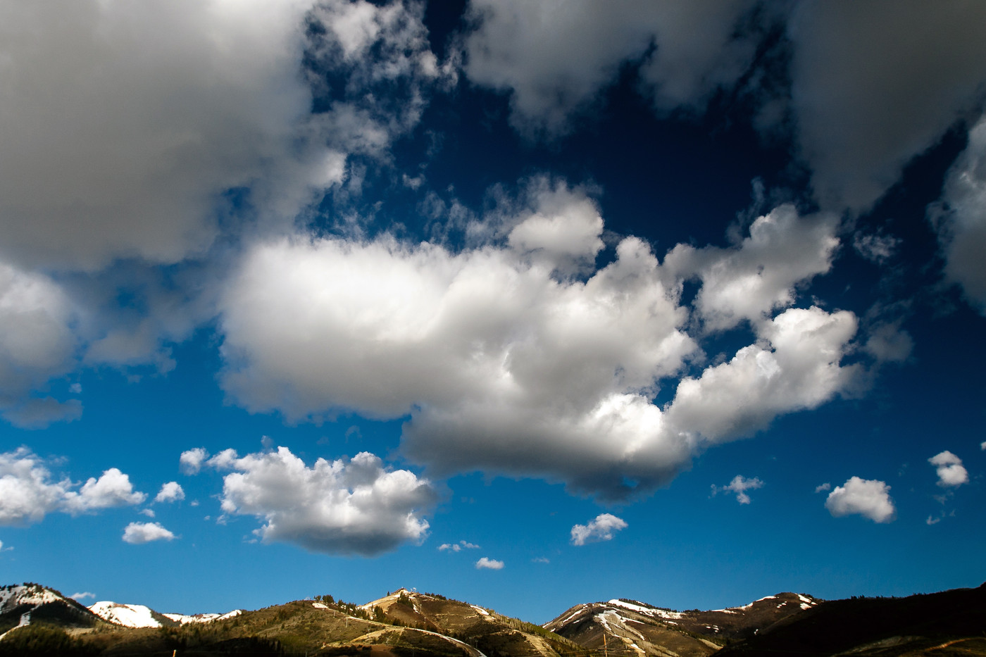 Cloudy skies over mountain tops.