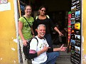 Zamora Spanish School Mates Linda & Rachael and I at a travel agent shop pointing to the weekend trip we took to Semuc Champey, Guatemala.