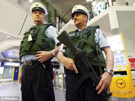 German police men on patrol in Berlins Tegel airport. Security has been tightened at airports and train stations because of a heightened risk of attack