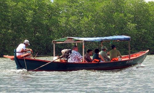 Tourists putt upstream