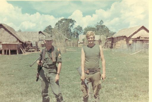 Me on the right, carrying an M79 Grenade Launcher.