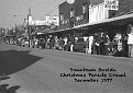 Crowd awaiting Christmas Parade in downtown Oneida in Dec 1977