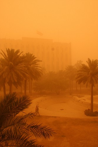 View of convention center grounds and apartment building in red zone during dust/sandstorm.
